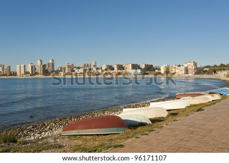 Traditional fishing boats at the modern resort of Campello, Costa Blanca, Spain - stock photo