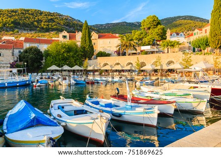 Traditional fishing boats in Bol port at sunset time, Brac island, Croatia