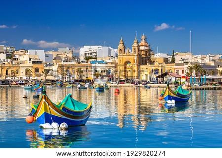 Traditional fishing boats in the Mediterranean Village of Marsaxlokk, Malta Stock fotó ©