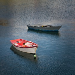 Traditional fishing rowboat in Finisterre harbor, in the Galician coast, Northern Spain. This rowboat are called