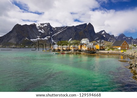 Traditional fishing village Sakrisoy on Lofoten islands in Norway with typical yellow buildings