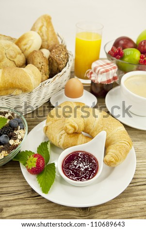traditional french breakfast in morning on wooden background