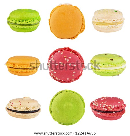 traditional french colorful macarons folded in pyramid on an isolated white background