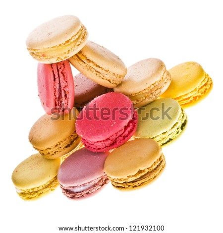 traditional french colorful macaroons stacked in a pyramid on  isolated white background