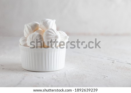 Traditional French dessert Meringue. White sweet meringue prepared from whipped with sugar and baked eggs on concrete background.  Foto d'archivio ©