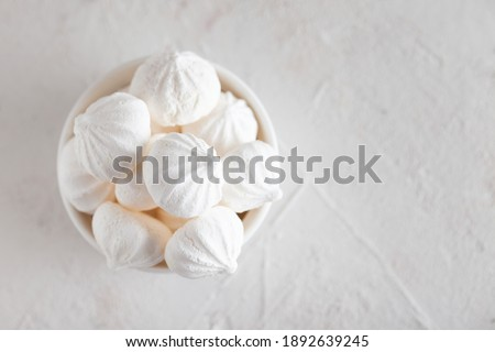 Traditional French dessert Meringue. White sweet meringue prepared from whipped with sugar and baked eggs on concrete background.  ストックフォト ©