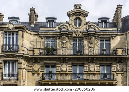Traditional French house with typical balconies and windows. Paris, France. #290850206