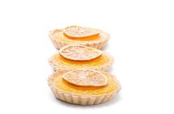Traditional french lemon tart, top viewTraditional french lemon tart, with orange slice