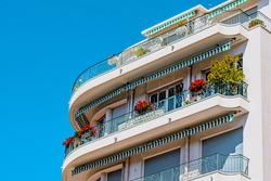 Traditional French old building with typical balconies and windows. Nice, France. High quality photo
