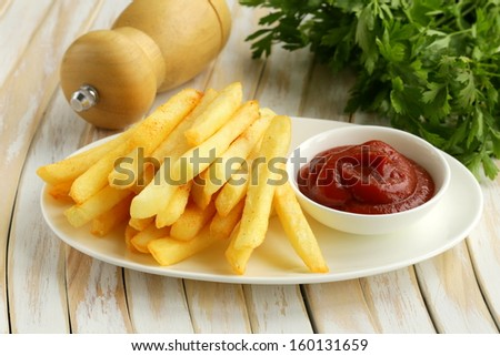 Traditional French potato fries with tomato ketchup