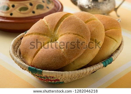 Traditional fresh baked Moroccan semolina bread in a basket for dinner