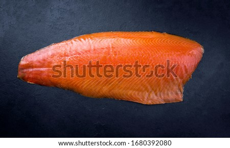 Traditional fresh graved salmon fillet offered as top view on a black board as background with copy space  Сток-фото ©
