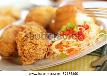 Traditional fried chicken dinner with silver fork