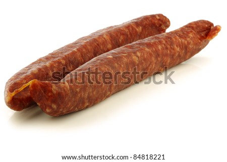 traditional frisian dried sausages on a white background