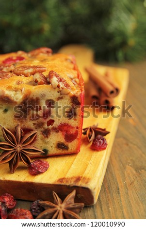 Traditional fruit cake for christmas with anise, cinnamon and dried cranberries