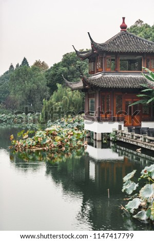 Traditional garden roof in Hangzhou, China. Decorative sculptures and shingles on an ancient building.