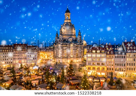 Photo of  Traditional German Christmas market in front of the Dresden Frauenkirche at the Neumarkt, Saxony, Germany