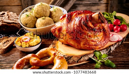 Traditional German cuisine, Schweinshaxe roasted ham hock, pretzel with obatzter cheese delicacy