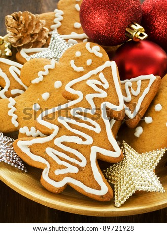 Traditional gingerbread cookies on the wooden plate. Shallow dof.