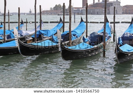 Traditional Gondola Boats Moored at Canal In Venice #1410566750