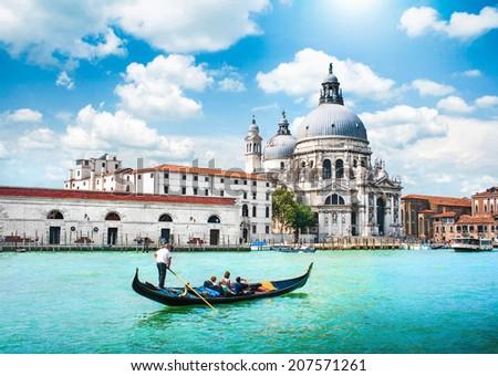 Traditional Gondola on Canal Grande with Basilica di Santa Maria della Salute in the background, Venice, Italy #207571261