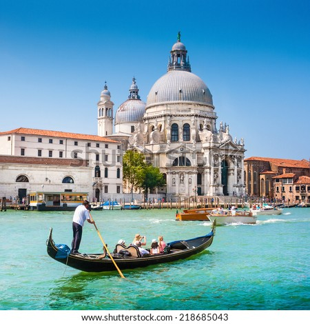 Traditional Gondola on Canal Grande with Basilica di Santa Maria della Salute in the background Venice Italy