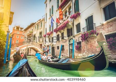 traditional gondolas on narrow...