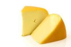 traditional Gouda cheese pieces on a white background