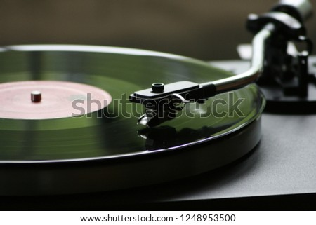traditional gramophone is playing music natural close up and nice background  #1248953500