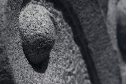 Traditional granite stone curve sculpture.Oriental style in monochrome for background,very shallow depth of field and selective focus.