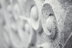 Traditional granite stone curve sculpture.Oriental style inmonochrome for background,very shallow depth of field and selective focus.