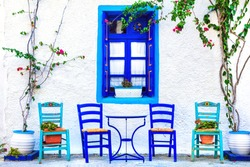Traditional Greece series - small cute street taverns (bars), with typical wooden chairs. Kos island