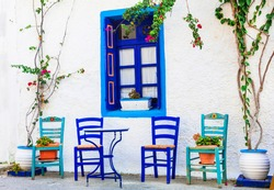 Traditional Greece series - wooden chairs in small street tavernas