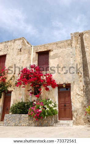 Traditional Greek architecture and building decoration with flowers, Crete, Greece