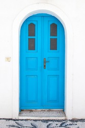 Traditional greek blue doors in white building
