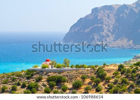 Traditional Greek church on the coast of Crete - stock photo