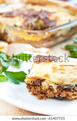 Traditional greek dish under white bechamel sauce