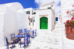 Traditional greek street with flowers in Amorgos island, Greece islands