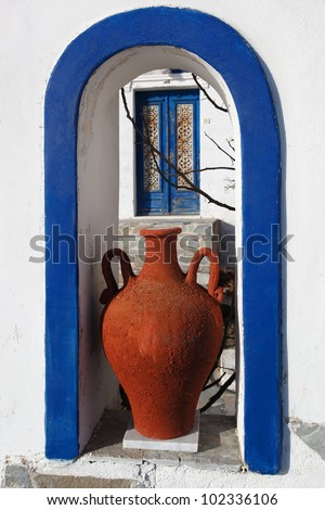Traditional Greek Vase with old door in Santorini, Fira, Greece - stock photo