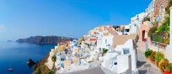 traditional greek village Oia of Santorini, street against Aegan sea and caldera, Greece, web banner format