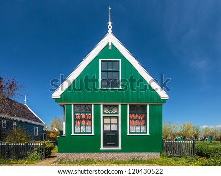 Traditional green Dutch historic house at the Zaanse Schans museum
