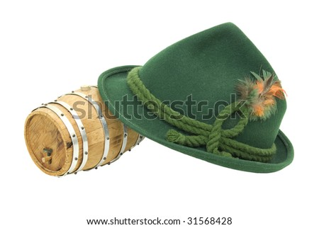 http://image.shutterstock.com/display_pic_with_logo/82356/82356,1244269043,1/stock-photo-traditional-green-felt-german-alpine-hat-with-rope-twists-and-bright-feathers-with-an-oak-barrel-31568428.jpg
