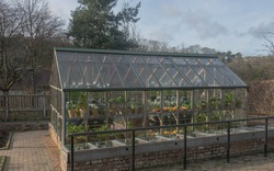 Traditional Greenhouse in a Vegetable Garden in Rural Devon, England, UK