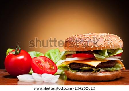 traditional hamburger and vegetables still life - stock photo