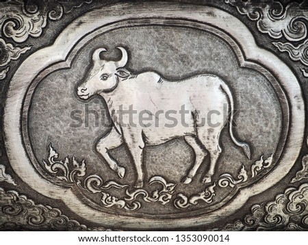 Traditional Hand Carved Silver Panel on the Temple Wall: Year of the Ox - Thai Zodiac Sign