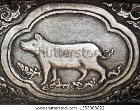 Traditional Hand Carved Silver Panel on the Temple Wall: Year of the Pig - Thai Zodiac Sign