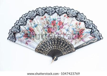 Traditional handheld fan. Flower painted folding fan. Oriental style open hand fan.