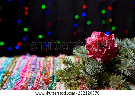 Traditional handmade decoration, spruce and striped textile