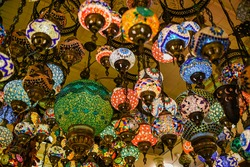 traditional handmade turkish lamps in souvenir shop. Mosaic of colored glass