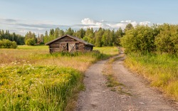 Traditional hay barn near Kalix typical for county Norrbotten in northern Sweden